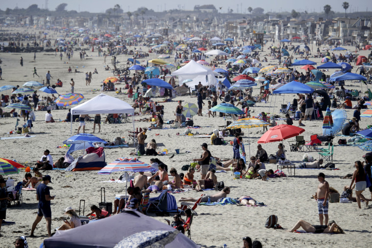 Image: People visit Newport Beach in California on May 24, 2020.
