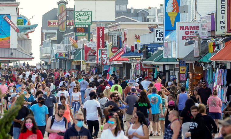 Image: Visitors crowd the boardwalk on Memorial Day weekend in Ocean City, Maryland