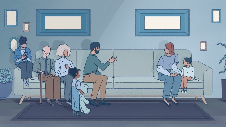 Image: A woman and her child sit on the right side of a couch, while other family members gesture at them from the other side.