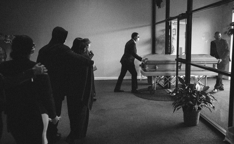 Image: The remains of Courtney Clark, who died of COVID-19, are taken from the funeral home in Elizabeth, N.J., on March 27, 2020.