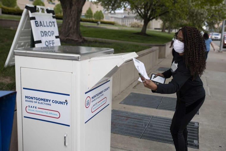 Image: An Ohio voter drops off her ballot at the Board of Elections in Dayton, Ohio on April 28, 2020.
