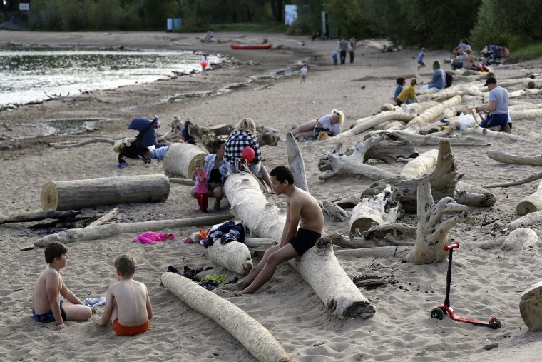 Image: People on a sandy shore of the Novosibirsk Reservoir on the Ob River in Sovetsky District of Novosibirsk, during the pandemic of the novel coronavirus disease