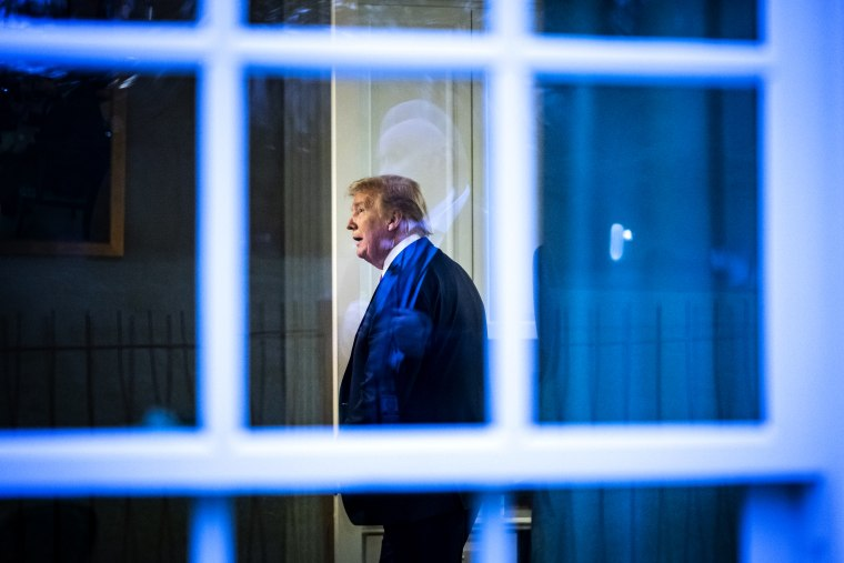 Image: President Donald Trump watches a television inside a press office at the White House on April 22, 2020.