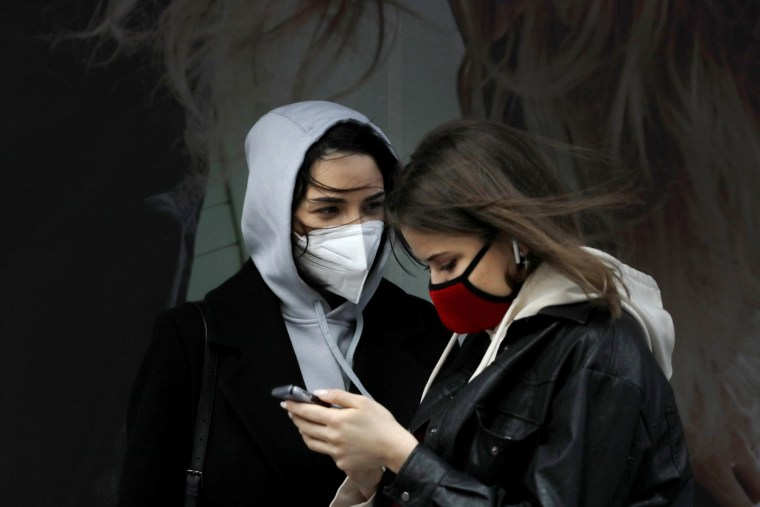 Image: Women wearing masks in New York's Times Square on April 9, 2020.