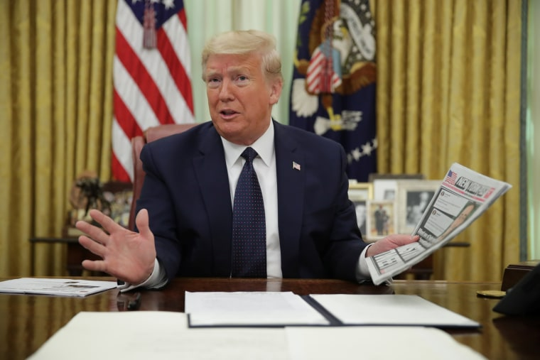 Image: President Trump signs executive order regarding social media companies at the White House in Washington