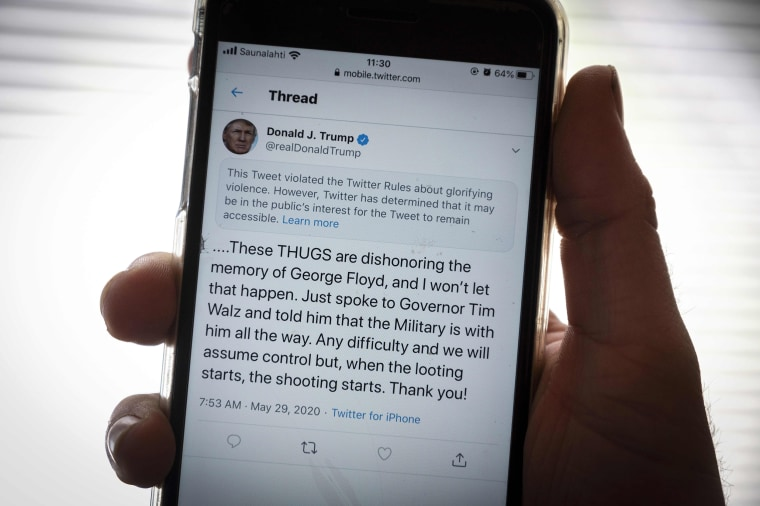 Image:The twitter page of President Donald Trump is displayed on a mobile phone