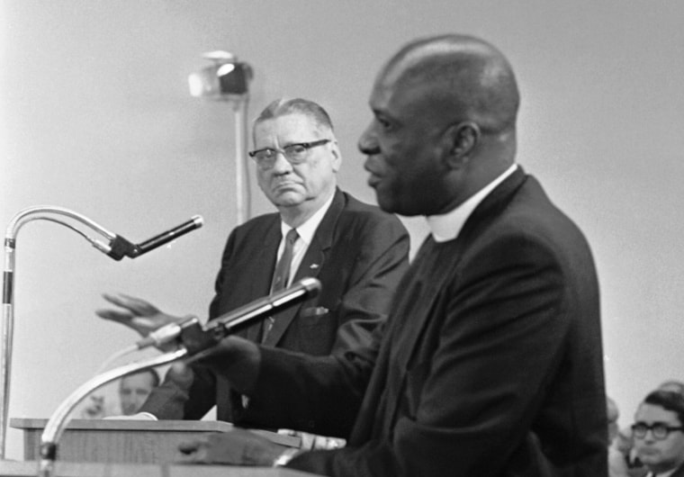 Image: Rev. Theodore Gibson, right, active in fostering smooth interracial relations in Miami, Fla., tells the Miami City Commission he favors strong action against crime, Dec. 30, 1967. He added he believed Miami Police Chief Walter Headley, left,