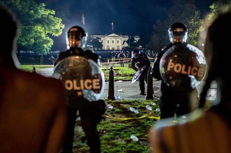 Image: Secret Service and park police form a line against protesters outside the White House on Saturday night, May 30, 2020.