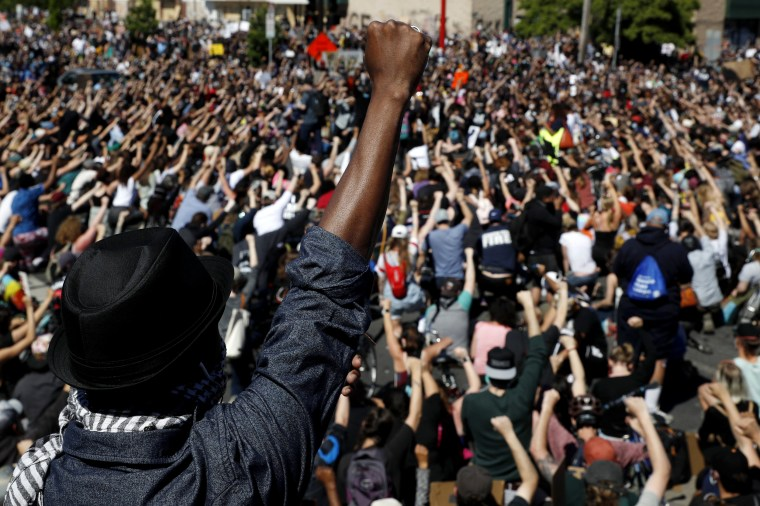 Image: Protesters raise their fist during a demonstration in Minneapolis on May 30, 2020.