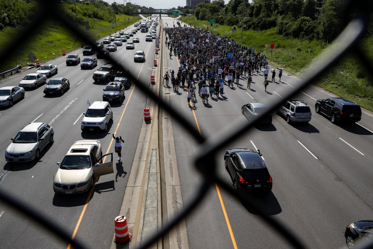Image: Protesters march down Highway 94 in St. Paul, Minn., on May 31, 2020.