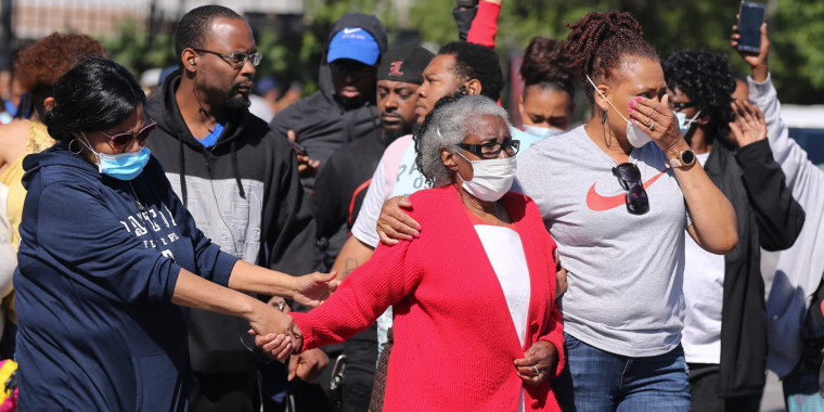 Odessa Riley, David McAtee's mother, is led to the site where her son was shot on June 1 in Louisville, Kentucky.
