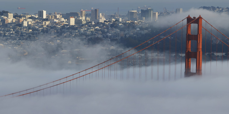 The Golden Gate Bridge and downtown San Francisco skyline engulfed in fog.