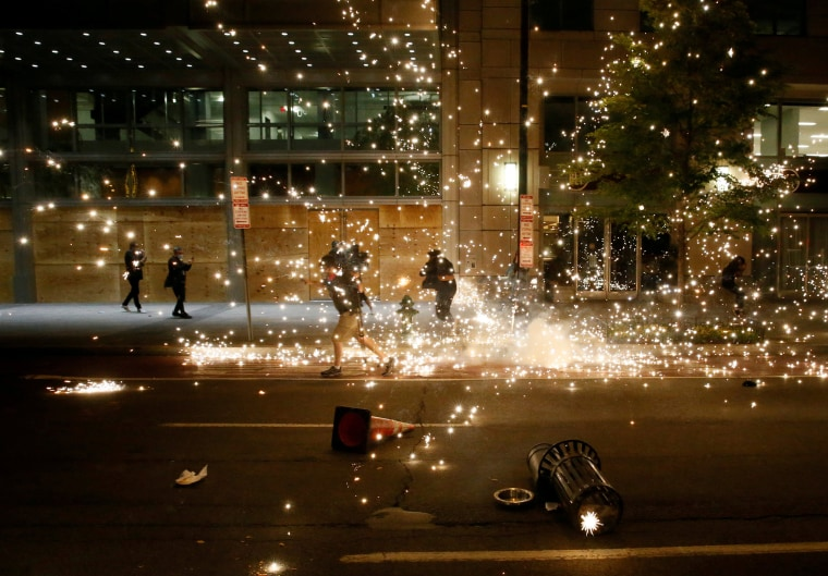 Image: People run as police disperse demonstrators during a protest amid nationwide unrest following the death in Minneapolis police custody of George Floyd, in Washington
