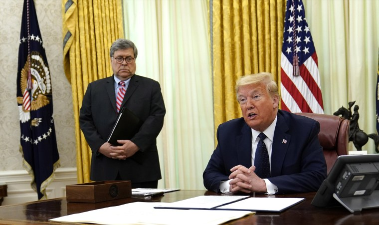 Image: President Donald Trump speaks before signing an executive order aimed at curbing protections for social media giants, in the Oval Office of the White House, Thursday, May 28, 2020, in Washington, as Attorney General William Barr listens.
