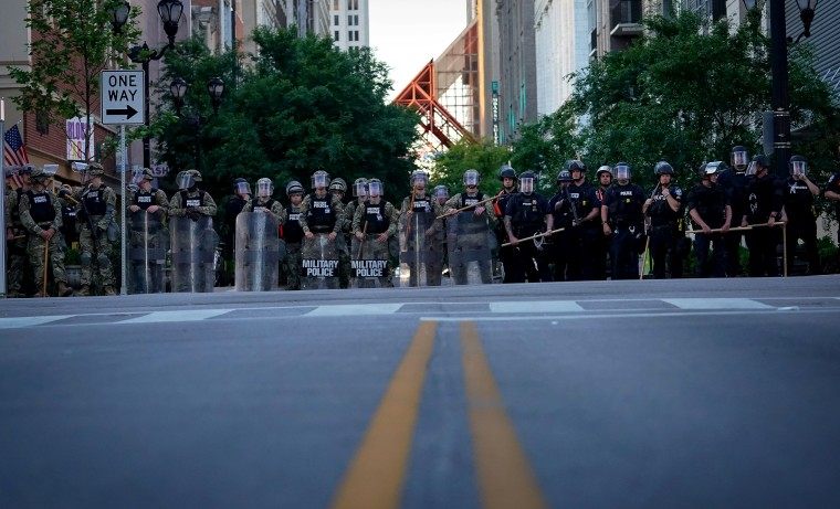 Image: The Army National Guard and Louisville Metro Police block a street during a protest in Kentucky on May 31, 2020.