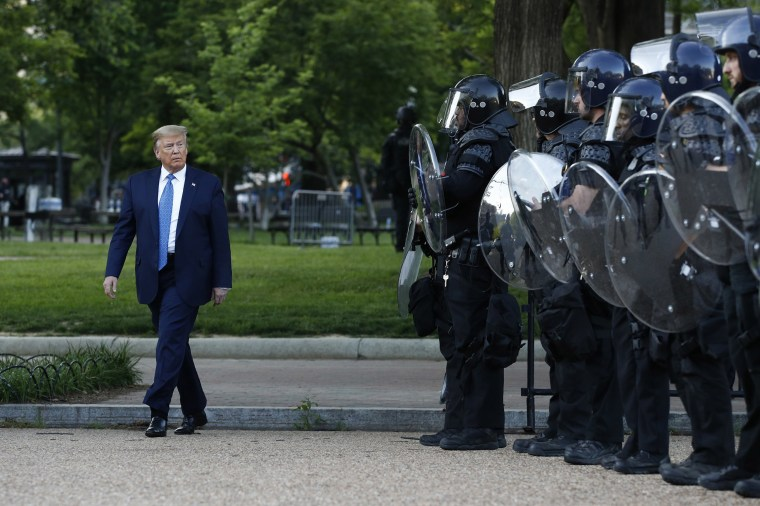 Image: President Donald Trump walks past police in Lafayette Park after visiting outside St. John's Church across from the White House Monday, June 1, 2020, in Washington.