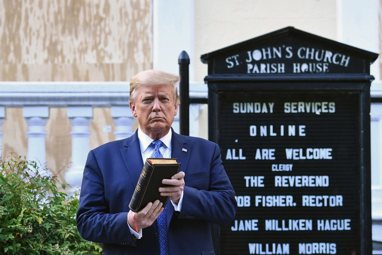 Image: President Donald Trump holds up a Bible outside of St John's Episcopal church across Lafayette Park in Washington, DC