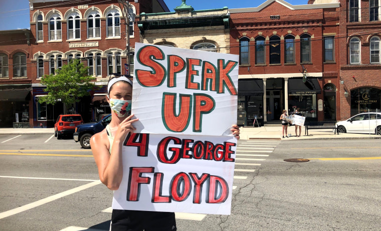 Madeline Blais, 27, protests against the killing of George Lloyd in Exeter, N.H., on May 30.
