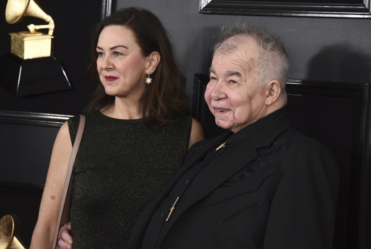 Image: Fiona Whelan Prine, left, and John Prine arrive at the 61st annual Grammy Awards in Los Angeles