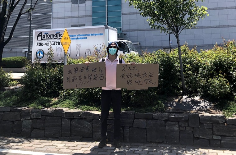Recent New York University graduate Jiang Li says he has been trying to purchase tickets back to China since April but has been unable to return. Late last month, he showed up to the Chinese Consulate in New York with a sign saying that his mom is waiting on him for dinner back home.