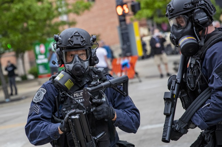 Police prepare to fire nonlethal projectiles just after the 7 p.m. curfew in Grand Rapids, Mich., on Monday, June 1, 2020.