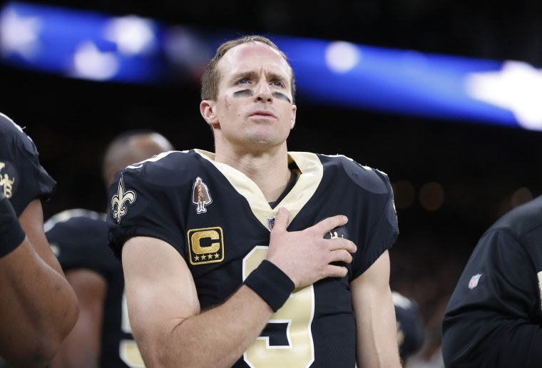 New Orleans Saints quarterback Drew Brees holds his hand to his heart during the national anthem before an NFL football game against the Pittsburgh Steelers in New Orleans on Dec. 23, 2018.