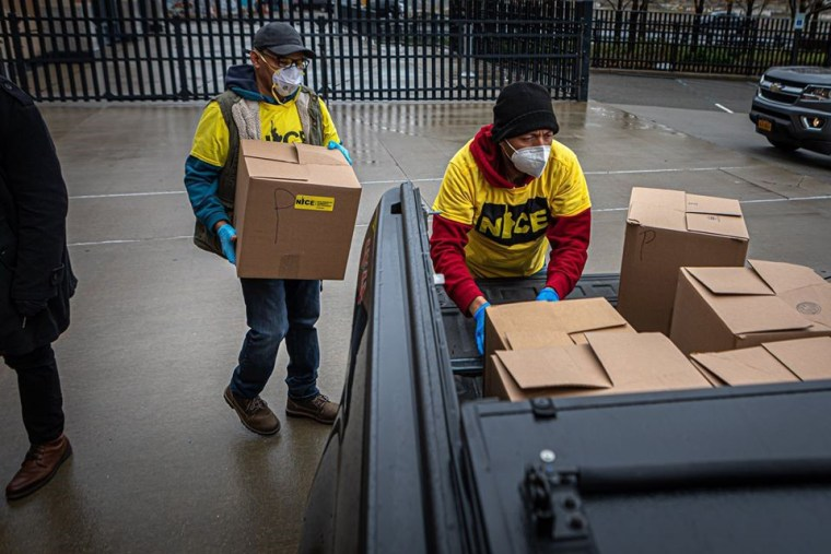 """Members of the """"relief brigades"""" organized by New Immigrant Community Empowerment in Queens, New York, with supplies that will be distributed to immigrant families."""