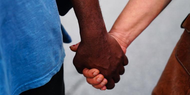 Image: Clasp hands, Atlanta Protest Held In Response To Police Custody Death Of Minneapolis Man George Floyd