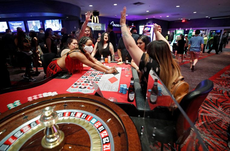 Image: Gamblers celebrate a win while playing roulette during the reopening of The D hotel-casino, closed by the state since March 18, 2020 as part of steps to slow the spread of the coronavirus disease (COVID-19), in downtown Las Vegas