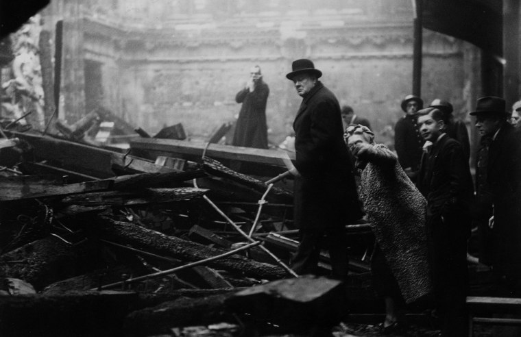 Image: British Prime Minister Winston Churchill and his wife inspect bomb-damage in the City of London during the Blitz