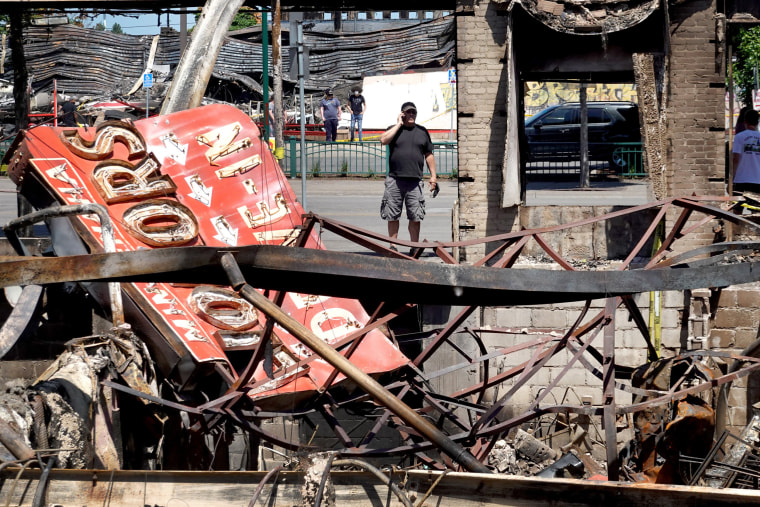 Image: The charred remains of a liquor store in Minneapolis