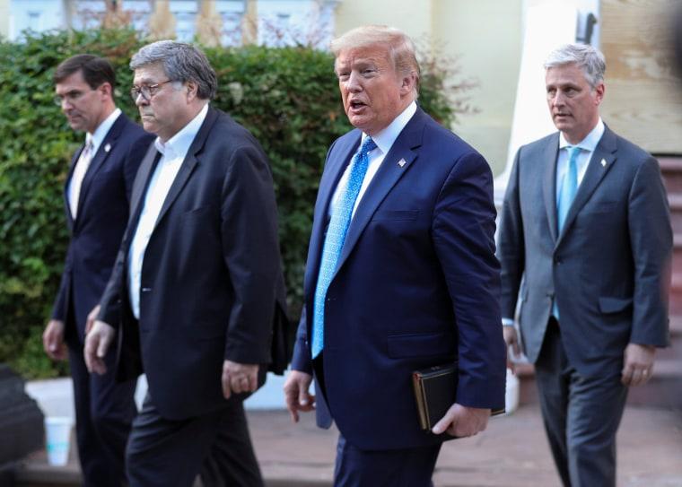 Image: President Donald Trump walks with  Defense Secretary Mark Esper, Attorney General Bill Barr and National Security Advisor Robert O'Brien