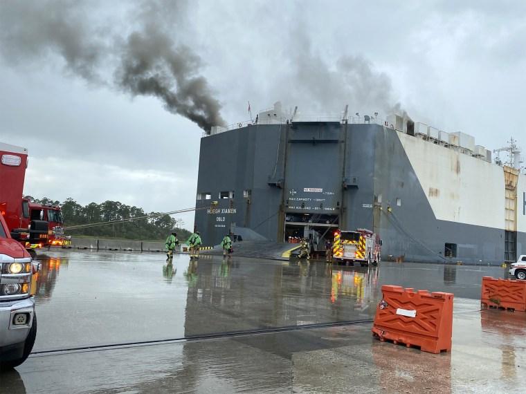 Image: Firefighters battle ship fire
