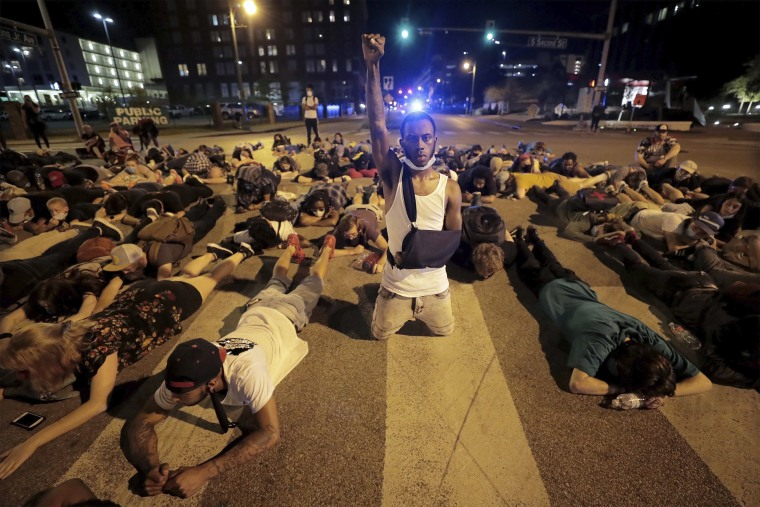 Image: Protesters lay in the middle of the intersection of Dr. Martin Luther King, Jr. Blvd. and Second Avenue in Memphis Thursday, June 4, 2020