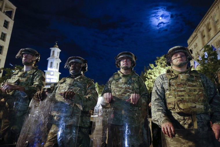 Image: Utah National Guard soldiers stand on a police line as demonstrators gather to protest the death of George Floyd near the White House.