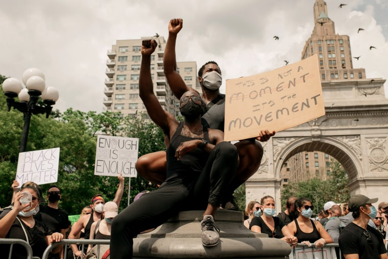 Image: Demonstrators raise their fists in solidarity as they protest in Washington Square Park in New York City on June 6, 2020.