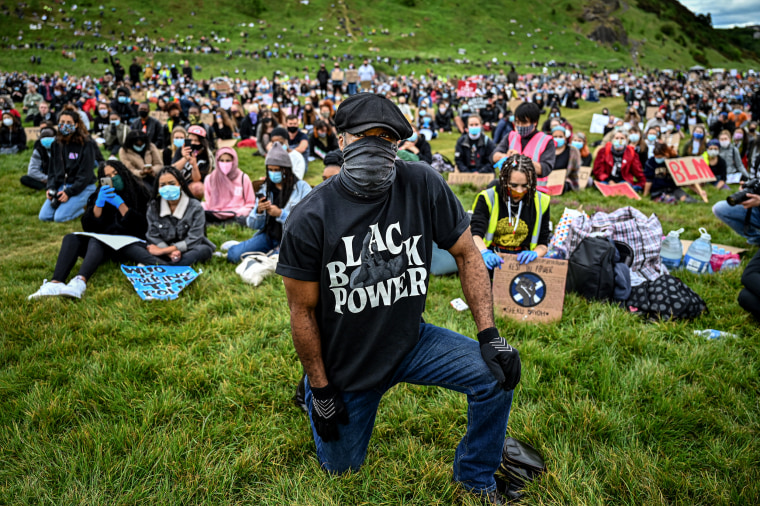 Image: A protester takes a knee during a demonstration in Holyrood Park, near Edinburgh, Scotland, on June 7, 2020.