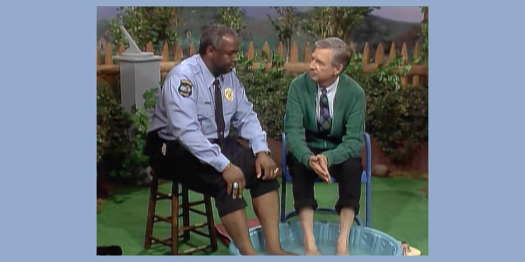 """In a 1993 episode of """"Mister Rogers' Neighborhood,"""" Rogers invited Officer Clemmons to soak his feet in a wading pool, a reference to a 1969 episode with a similar scene, which aired amid civil unrest over racially segregated pools."""