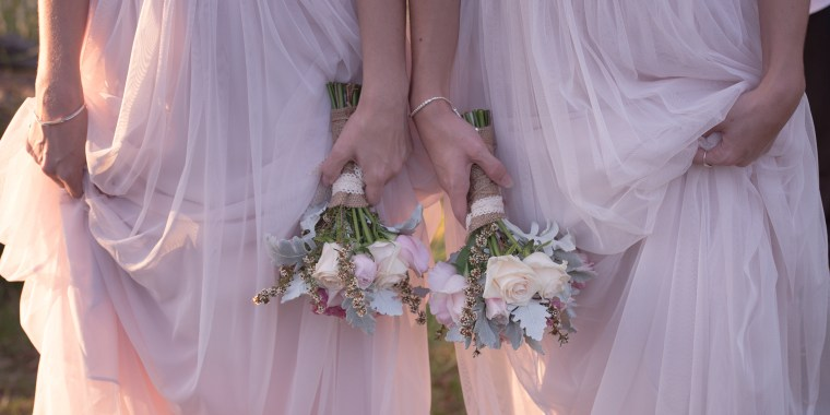 Midsection Of Bridesmaids Holding Bouquets