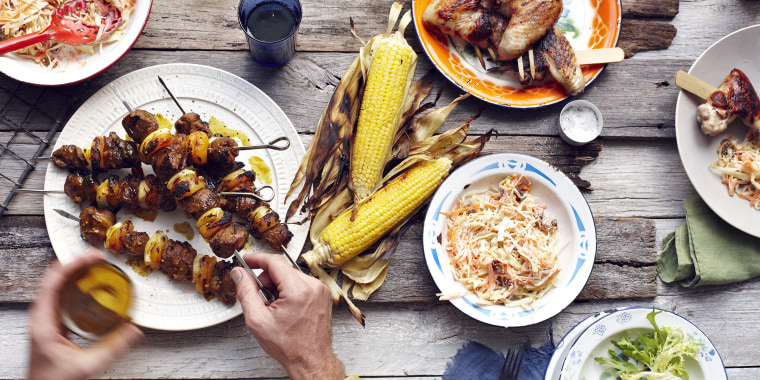 Use the grill, but ask guests to bring their own utensils and sides — and offer a separate table for visitors.