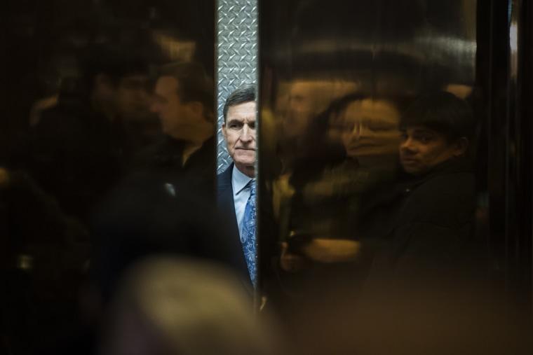 Image: Retired Lt. Gen. Michael Flynn boards an elevator at Trump Tower