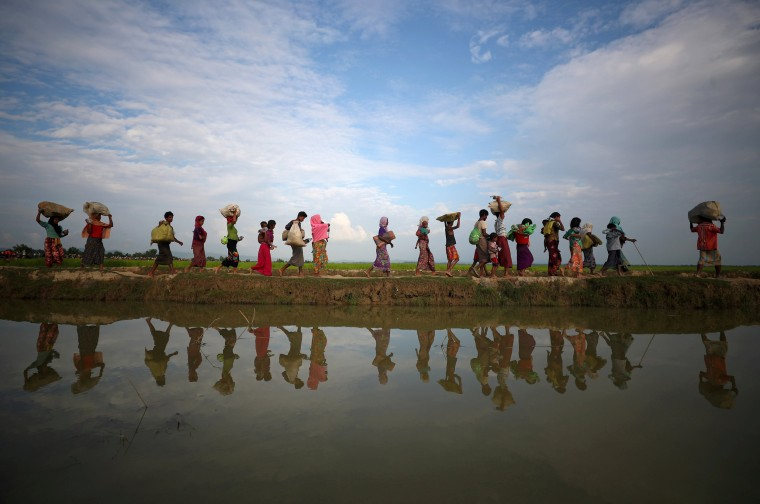 Image: Rohingya refugees after crossing from Myanmar into Palang Khali, near Cox's Bazar