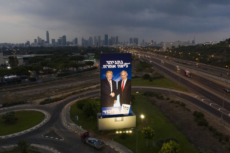 Image: A massive election campaign billboard of the Likud party shows Israeli Prime Minister Benjamin Netanyahu, right, and President Donald Trump in Tel Aviv, Israel