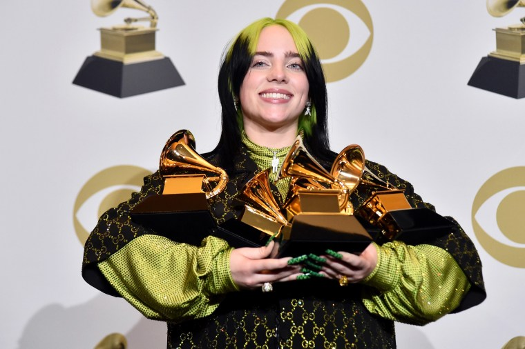 Image: Billie Eilish poses in the press room during the 62nd Annual GRAMMY Awards at STAPLES Center