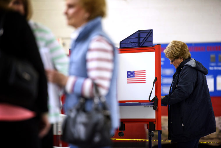 Image: A woman fills out her ballot in St. Pauls, N.C., on Super Tuesday on March 3, 2020.