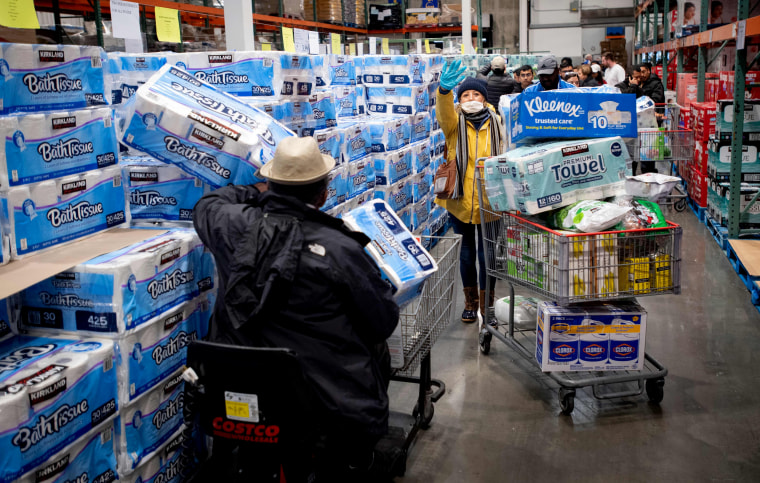 Image: People shop for toilet paper and other provisions at a Costco store in Novato, Calif., on March 14, 2020.