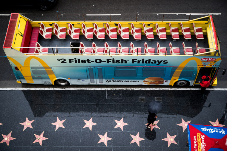 Image: An empty tour bus near the walk of fame in Hollywood, Calif., on March 13, 2020.