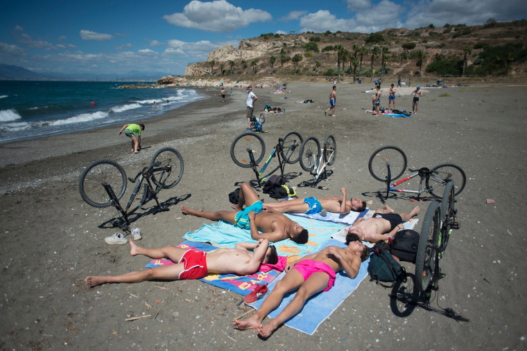 Image: People sunbathe at La Arana Beach in Malaga on June 7, 2020, as lockdown measures are eased during the novel coronavirus COVID-19 pandemic.