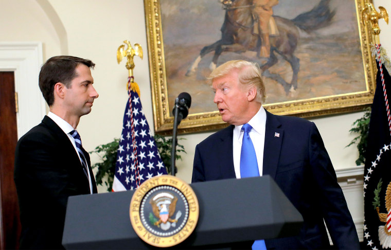 U.S. President Donald Trump leaves after delivering remarks on immigration reform, accompanied by Senator Tom Cotton in the Roosevelt Room of the White House in Washington