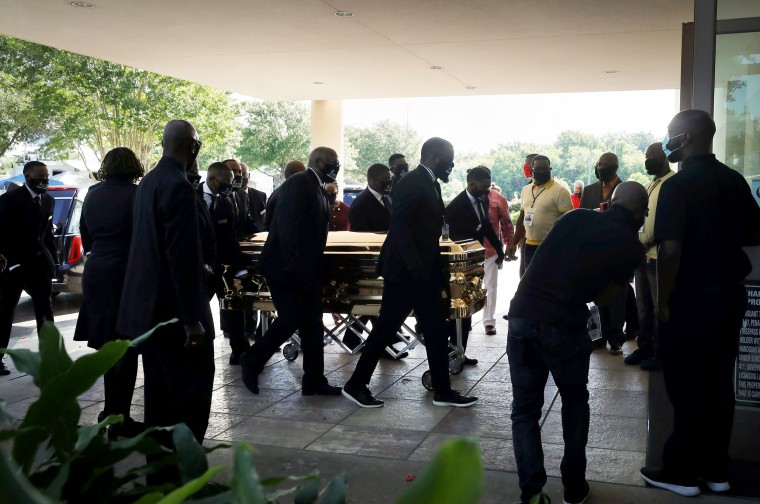 Image: Pallbearers bring George Floyd's casket into the Fountain of Praise Church for a memorial and viewing services in Houston, Texas, on June 8, 2020.